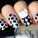 Polka Dots with Bow Nail Art
