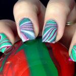 Holiday water marble nail design